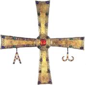 Cruz de Peñalba, regalada por Ramiro a Genadio en el siglo X. La puerta del cementerio está coronada por una réplica de la misma.